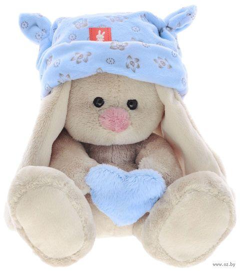 """Мягкая игрушка """"Зайка Ми малыш в голубой шапке с сердечком"""" (15 см) — фото, картинка"""